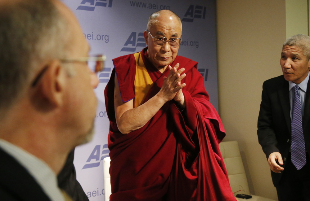 "The Dalai Lama leaves after speaking at an event titled ""Happiness, Free Enterprise, and Human Flourishing"" at the American Enterprise Institute in Washington on Thursday."