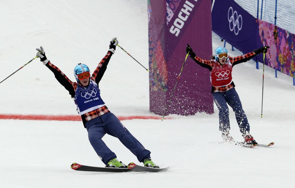 Canada's Marielle Thompson, left, celebrates winning the gold medal ahead of compatriot Kelsey Serwa in the women's ski cross final at the 2014 Winter Olympics.