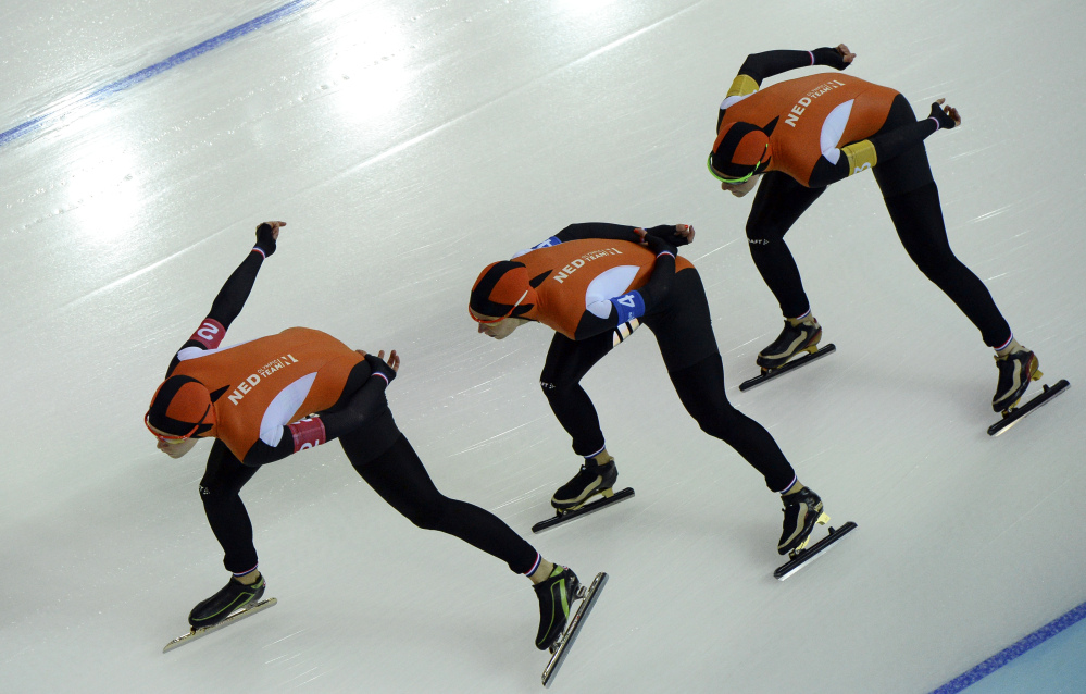 Speedskaters from the Netherlands, left to right, Jorien ter Mors, Ireen Wust, and Lotte van Beek compete in the women's speedskating team pursuit quarterfinals at the Adler Arena Skating Center at the 2014 Winter Olympics, Friday, Feb. 21, 2014, in Sochi, Russia. (AP Photo/Antonin Thuillier, Pool)