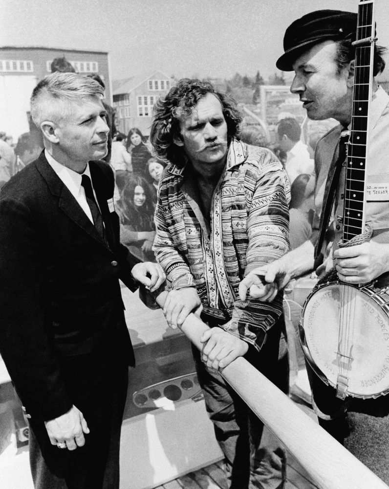 Gov. Kenneth Curtis left, and folk singer Pete Seeger attend the 1969 launching of the sloop Clearwater at South Bristol.