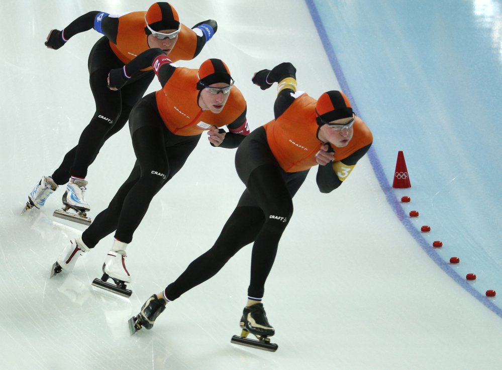 Speedskaters from the Netherlands, left to right, Koen Verweij, Jan Blokhuijsen and Sven Kramer skate their way to gold in the men's team pursuit race at the Adler Arena Skating Center Saturday at the 2014 Winter Olympics in Sochi, Russia.