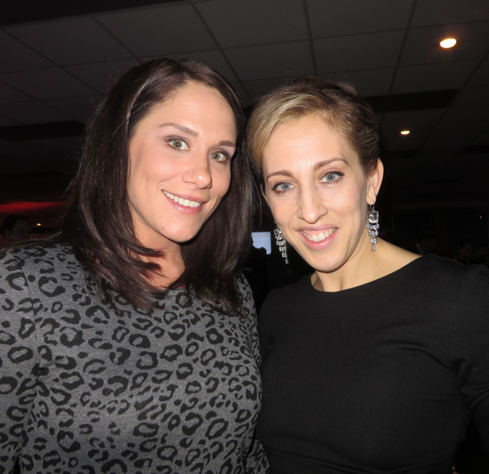 Lianna Doane, manager of special events, with silent auction chairperson Katie Hogan, both of Falmouth.