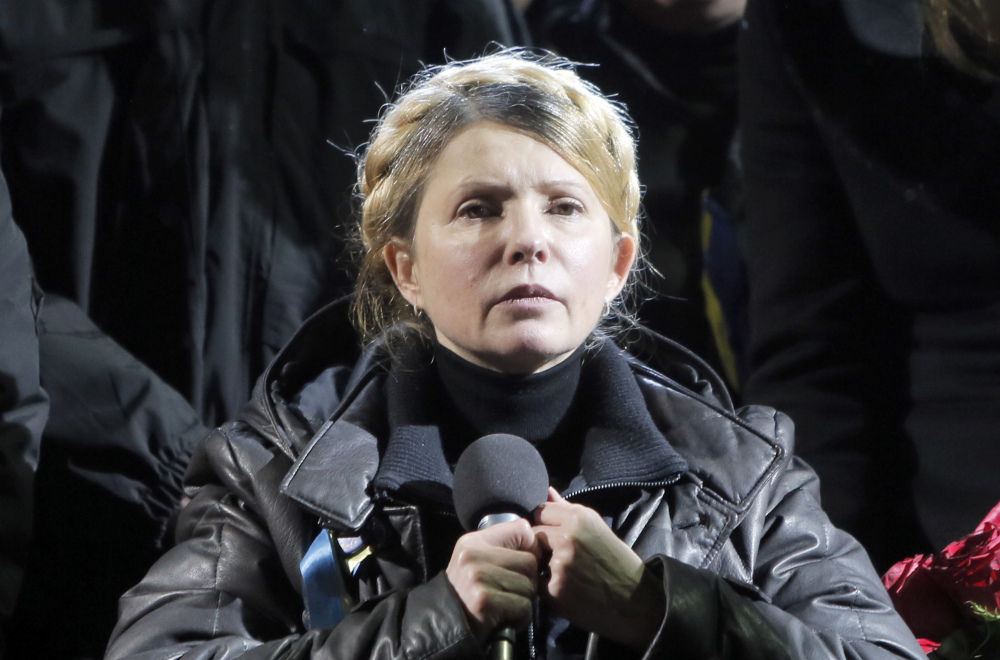 Former Ukrainian prime minister Yulia Tymoshenko addresses the crowd in central Kiev, Ukraine, Saturday. Hours after being released from prison, former Ukrainian prime minister and opposition icon Yulia Tymoshenko praised the demonstrators killed in violence this week as heroes.