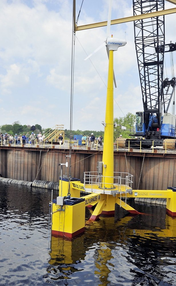 A prototype floating wind turbine put together by the DeepCwind Consortium sits in water at Cianbro's Eastern Manufacturing Facility in Brewer on May 13.