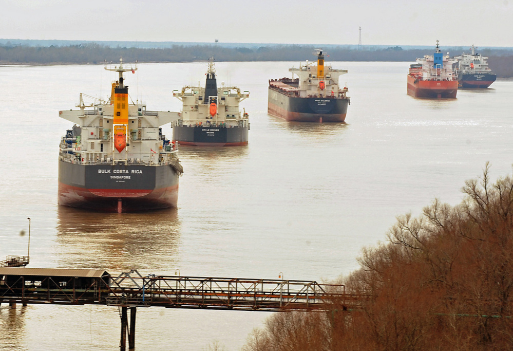 Ships sit idle along the banks of the Mississippi River on Monday, after a barge collision near Vacherie, La., on Saturday resulted in an oil spill. The Coast Guard reopened the normally bustling stretch of the Mississippi River on Monday.