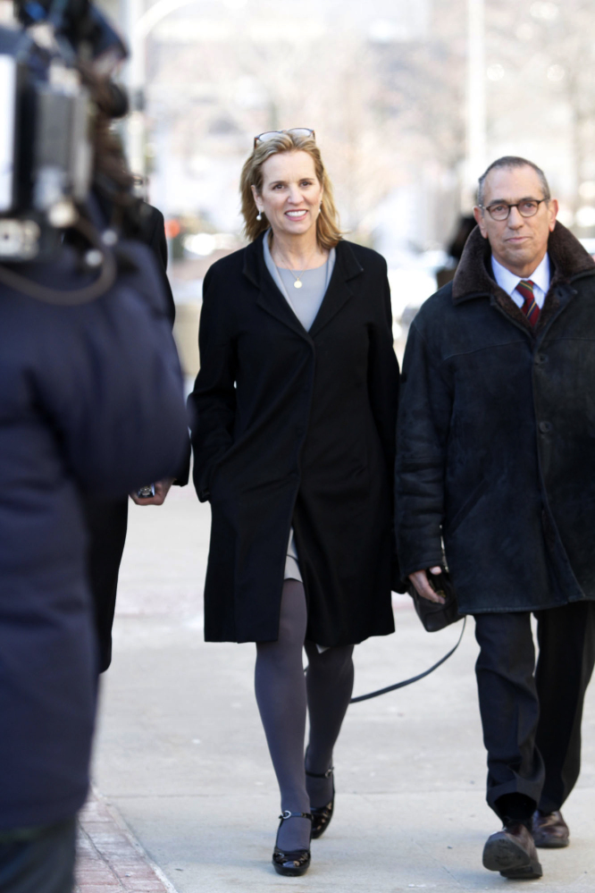 Kerry Kennedy, center, arrives, Monday at a courthouse for her trial in White Plains, N.Y. The trial is expected to last a week.