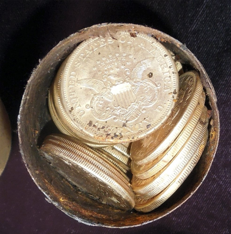 A metal canister is filled with gold coins found in Northern California.