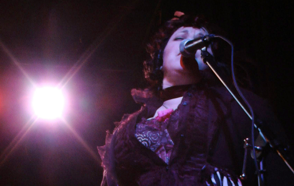 """""""Mama Dixie"""" sings during a performance of the Pink Box Burleseque troupe in Tuscaloosa, Ala., recently. The audience at the show was nearly as varied as the cast. College-age guys mingled with retired couples, and a group of young women yelled encouragement from the side."""