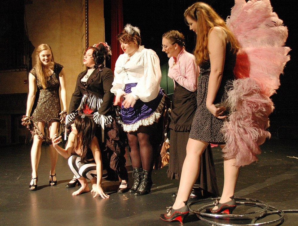 Members of the Pink Box Burlesque troupe gather on stage at the Bama Theatre in Tuscaloosa, Ala. The group, now in its seventh season, is part of a rebirth of the art of burlesque in recent years.