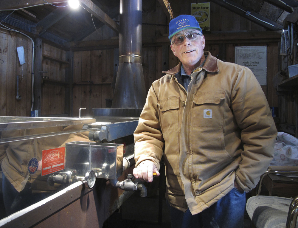 Maple syrup maker Ron Wenzel poses inside his sugar shack Tuesday in Hebron, Conn. He didn't start tapping his trees until this past weekend, when temperatures in the 40s and 50s finally allowed the sap to flow.