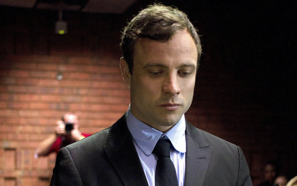 Double-amputee Olympian Oscar Pistorius appears in court to be indicted on charges of murder in the shooting death of Reeva Steenkamp in this Aug. 19, 2013, photo.