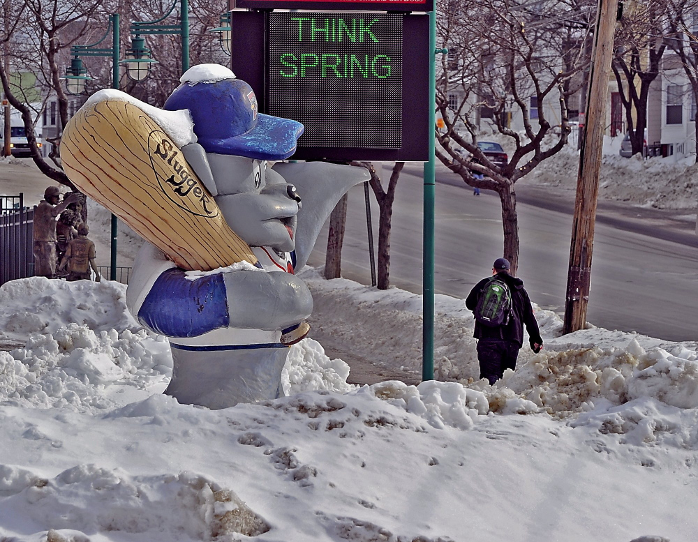 """It's hard to """"think spring"""" when the snow is waist-high on Slugger, the Portland Sea Dog's mascot in front of Hadlock Field on Park Avenue in Portland. But thinking about spring might just give Portlanders some hope in what has been an extreme winter, according to one index."""