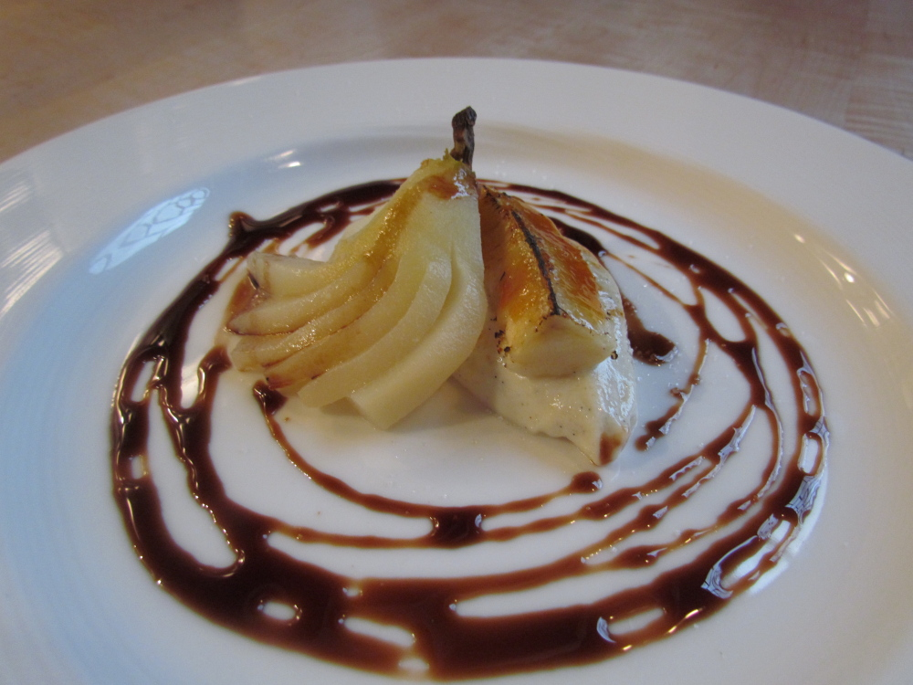 The perfect ending to the meal might include poached forrel pear, banana ricotta brulee with a balsamic reduction.