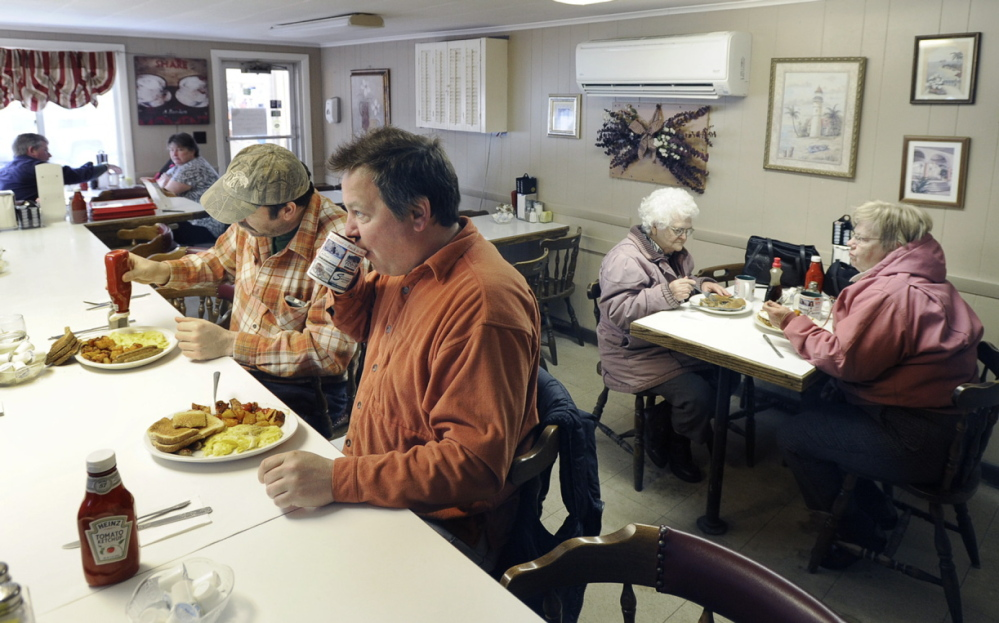 Chris Odlin and Jason Lovejoy, both of Scarborough, enjoy hearty breakfast fare at Guidi's.