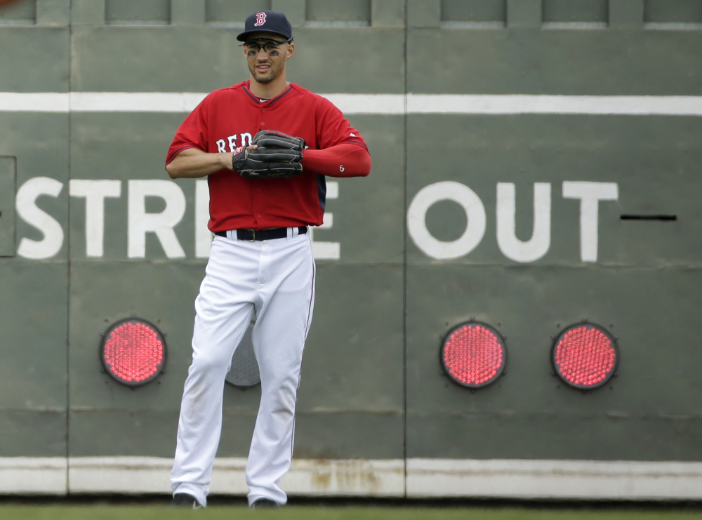 Boston Red Sox center fielder Grady Sizemore stands near the scoreboard in the outfield during the second inning of an exhibition baseball game against Northeastern University on Thursday in Fort Myers, Fla.