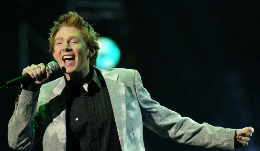 Singer Clay Aiken performs onstage at the 31st annual American Music Awards in Los Angeles in 2003.