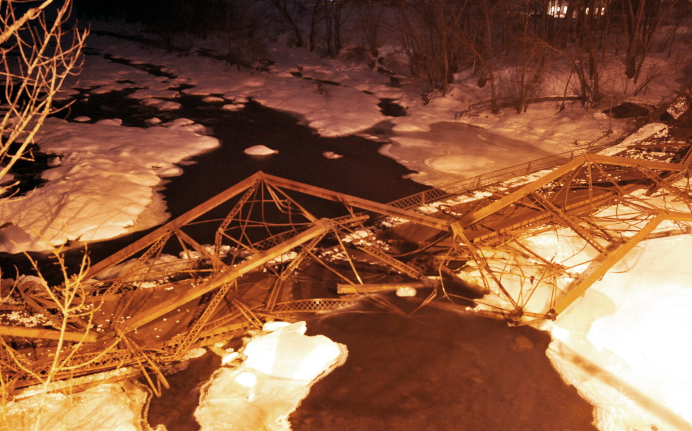 The New Sharon bridge sits in the Sandy River after finally crashing down late Thursday afternoon.