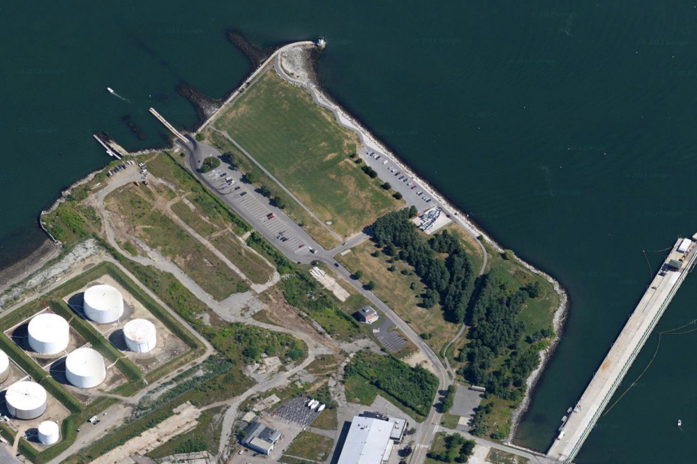 John Cacoulidis proposed building a concert venue on a tract next to Bug Light Park in South Portland, immediately above the oil tanks in this photo.