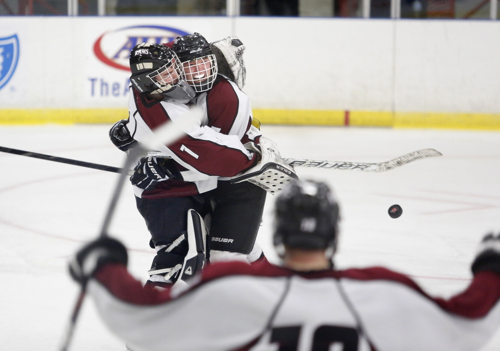 Justin Broy, left, and Dylan Turner of Gorham celebrate after defeating Kennebunk, Friday, Feb. 28, 2014, in the Class B West semifinal game at the Colisee in Lewiston.
