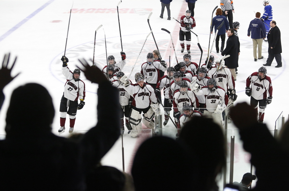Gorham teammates recognize their fans, Friday, Feb. 28, 2014, after defeating Kennebunk in the Class B West semifinal game.