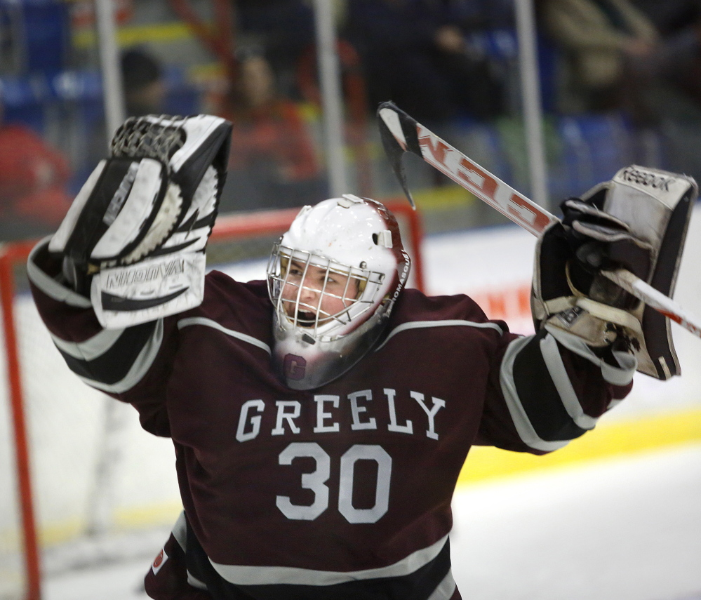Greely goalie Kyle Kramlich celebrates after the Rangers defeated Camden Hills 3-2 Friday night in a Western Class B boys' hockey semifinal at the Colisee in Lewiston.