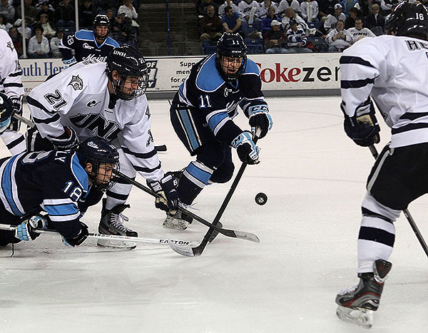 Brothers in arms and by birth, Jon Swavely, bottom left, and Steven Swavely sometimes play on the same line for UMaine, though center is their regular position.