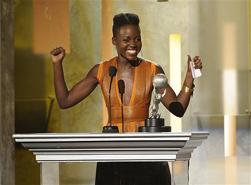 """Lupita Nyong'o accepts the award for outstanding supporting actress in a motion picture for """"12 Years a Slave"""" at the 45th NAACP Image Awards on Saturday in Pasadena, Calif."""