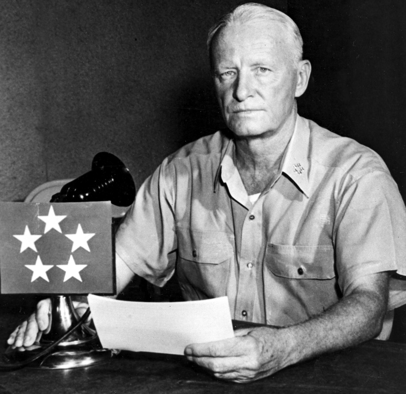 U.S. Fleet Adm. Chester W. Nimitz poses while reading the communique from his advance headquarters in Guam on April 1, 1945, during World War II, when he revealed to the world the news of the U.S. invasion of Okinawa, 325 miles from Tokyo.