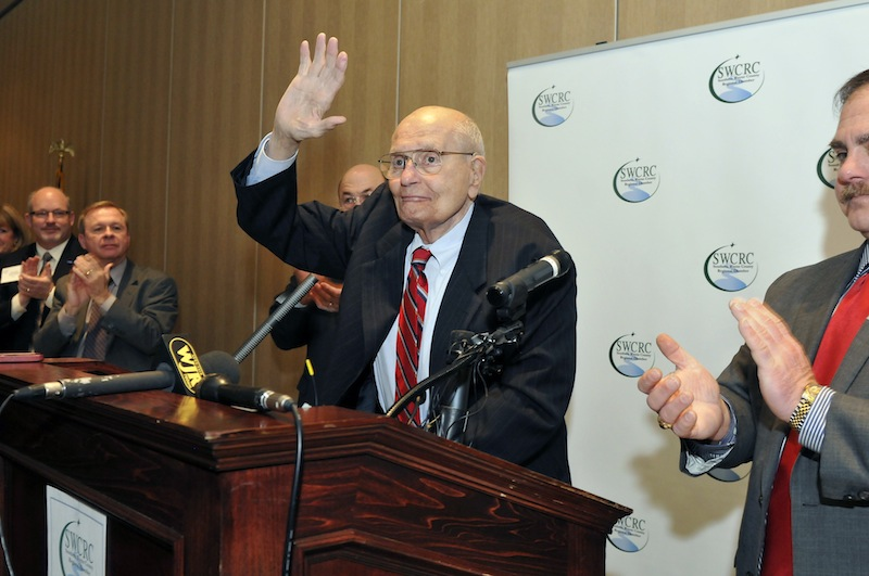 U.S. Rep. John Dingell, center, is welcomed as he arrives at the Southern Wayne County Regional Chamber Legislative forum held at the Crystal Gardens in Southgate, Mich. on Monday. Dingell, the longest-serving member of Congress in American history and a champion of Detroit's auto industry, has announced his retirement.