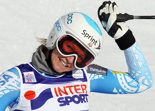 Julia Mancuso, of the United States, smiles in the finish area after completing an alpine ski, women's World Cup super-g, in Cortina d'Ampezzo, Italy, Thursday, Jan. 23, 2014. Mancuso finished in seventh place. (AP Photo/Armando Trovati)