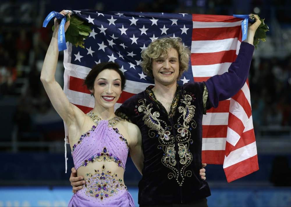 Meryl Davis and Charlie White of the United States pose for photographers with the U.S. flag after placing first in the ice dance free dance figure skating finals at the Iceberg Skating Palace during the 2014 Winter Olympics, Monday, Feb. 17, 2014, in Sochi, Russia. (AP Photo/Darron Cummings) 2014 Sochi Olympic Games,Winter Olympic games,Olympic games,Sports,Events,XXII Olympic Winter Games