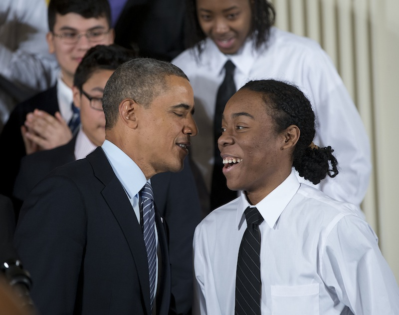 """President Barack Obama speaks with Christian Champagne, 18, a senior at Hyde Park Career Academy in Chicago, on Thursday before launching an initiative to provide greater opportunities for young black and Hispanic men called """"My Brother's Keeper."""""""