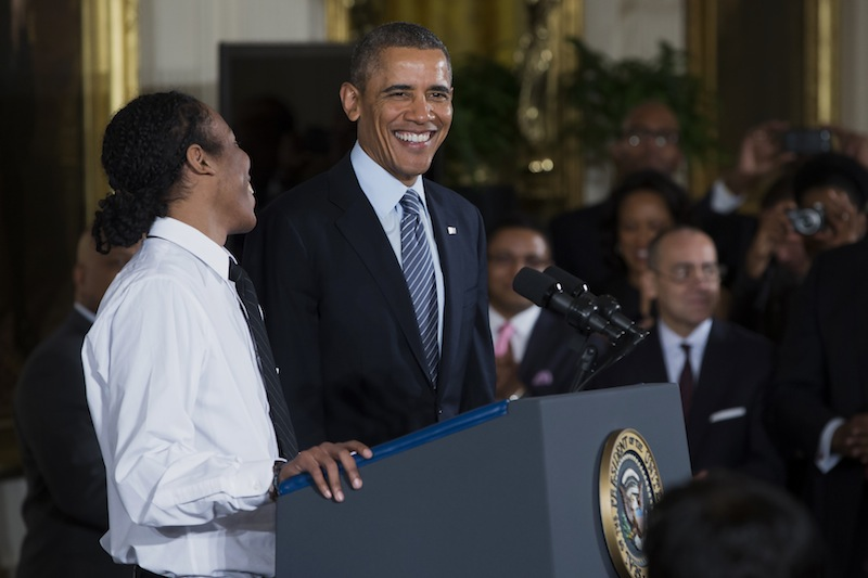 """President Barack Obama laughs as he is introduced by Christian Champagne, 18, a senior at Hyde Park Career Academy in Chicago, during an event in the East Room of the White House in Washington on Thursday to promote his """"My Brother's Keeper"""" initiative."""