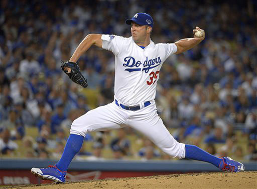 Chris Capuano, shown pitching for the Los Angeles Dodgers, worked out with the Boston Red Sox on Saturday after signing a $2.25 million, one-year contract.