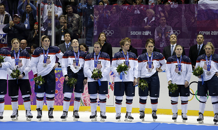 Team USA reacts after receiving their silver medals after losing to Canada 3-2 in overtime of the gold medal women's ice hockey game at the 2014 Winter Olympics, Wednesday, Feb. 19, 2014, in Sochi, Russia. (AP Photo/David Goldman) 2014 Sochi Olympic Games;Winter Olympic games;Olympic games;Spor
