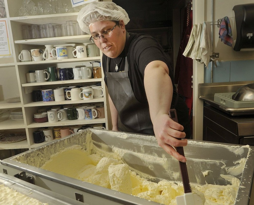 Alicia Menard of Casco Bay Butter Co. checks the consistency of a batch.