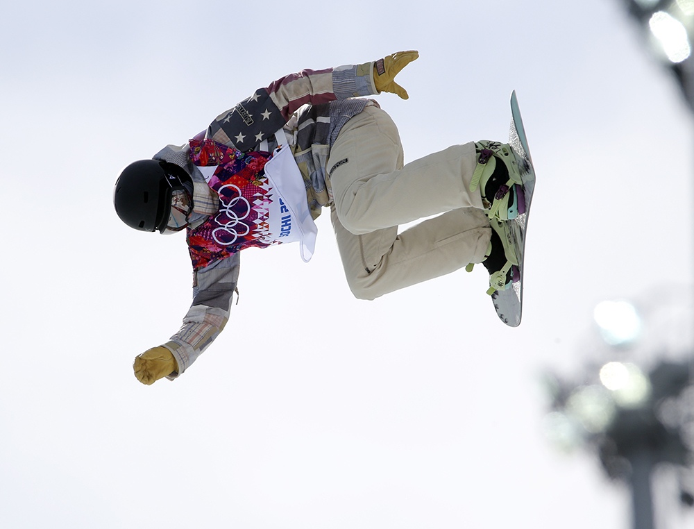 United States' Kelly Clark competes in the women's snowboard half pipe qualifying round at the Rosa Khutor Extreme Park, at the 2014 Winter Olympics, Wednesday, Feb. 12, 2014, in Krasnaya Polyana, Russia.