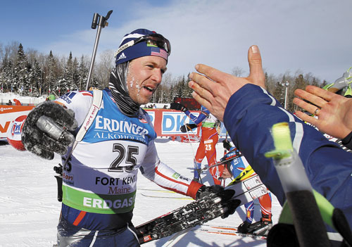 SHOCKER: Lowell Bailey, of Lake Placid, N.Y., accepts congratulations after finishing in ninth place in the men's 15-kilometer mass start race Sunday at the Biathlon World Cup in Fort Kent. Bailey credited the local crowd with propelling him to a top 10 finish.