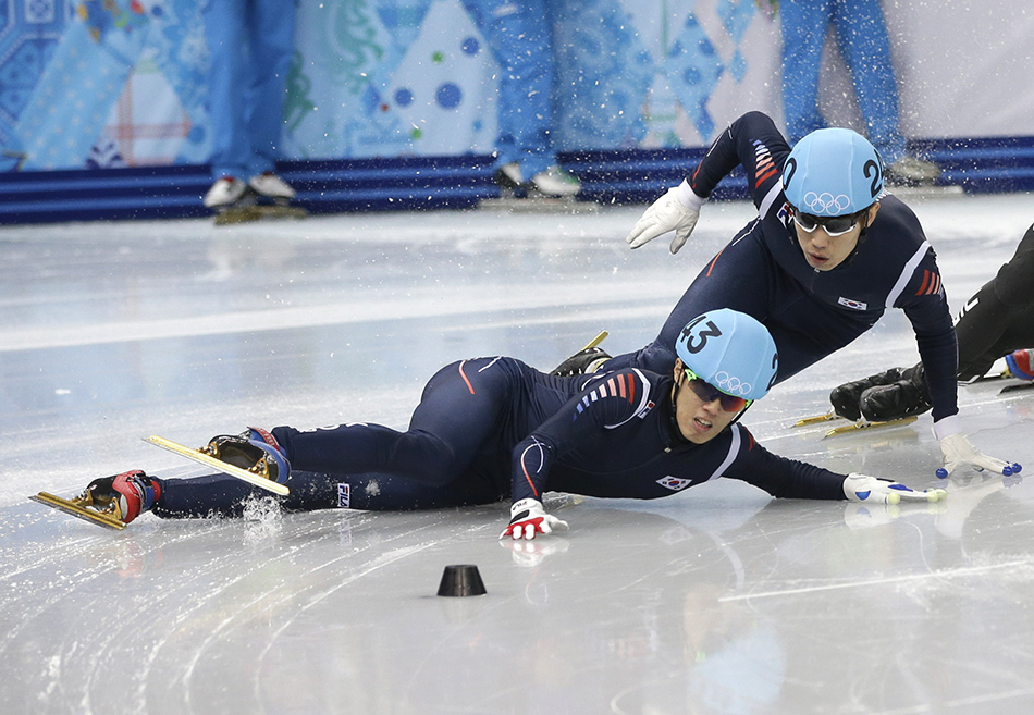 Sin Da-woon of South Korea, left, crashes as Lee Han-bin of South Korea goes down with him in a men's 1500m short track speedskating semifinal at the Iceberg Skating Palace during the 2014 Winter Olympics, Monday, Feb. 10, 2014, in Sochi, Russia. (AP Photo/Darron Cummings) 2014 Sochi Olympic Games;Winter Olympic games;Olympic games;Spor