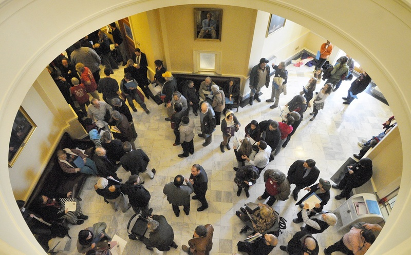 The third-floor hallway between House and Senate chambers is crowded with people attending a rally held to support Medicaid expansion on the first day of this year's legislative session on Jan. 8 at the State House in Augusta.