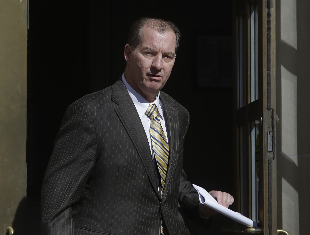 Former Central Falls, RI., Mayor Charles Moreau walks out of the federal courthouse in Providence, R.I., Friday after serving just under one year of a two-year sentence.