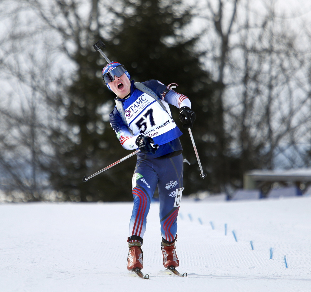 Kamran Husain lets out a yell as he crosses the finish line in Presque Isle on Friday. His experience was similar to that of Russell Currier in 2006 in the same junior world championships at the same venue.