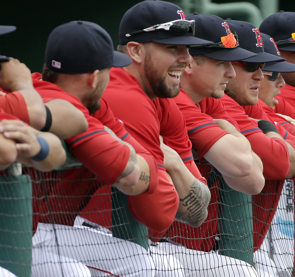Anthony Ranaudo, center, has reason to smile as Boston's one-time top pitching prospect threw two perfect innings against the Minnesota Twins on Friday.