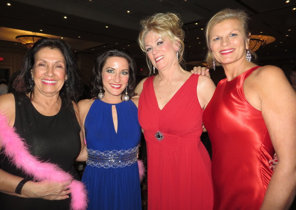 Event committee members Rita Yarnold, chair of the Greater Portland Board of Realtors Habitat Committee, with dancing Realtors Lisa DiBiase of Landing Real Estate, Karen Jones of Coldwell Banker, and Susan Hight of Wells Fargo Mortgage.