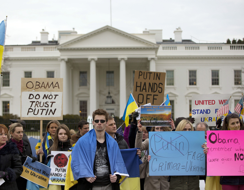 Demonstrators express their sentiments outside the White House in Washington on Saturday. While many are troubled by Russia's actions in the Crimean Peninsula, there may be little that the West can do to keep it in line.