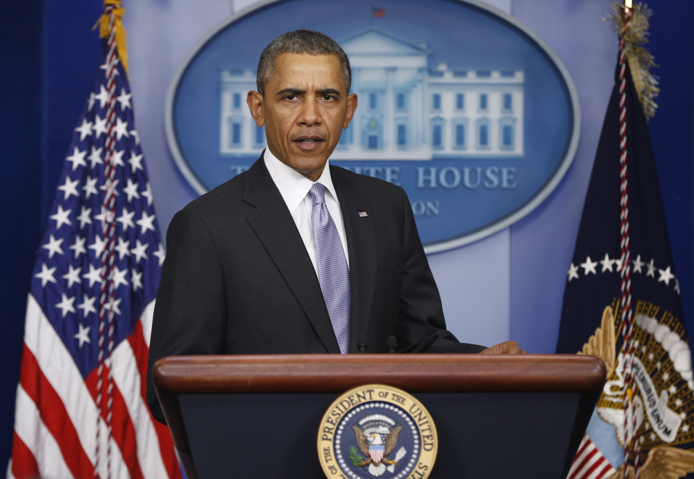 President Barack Obama arrives to speak about Ukraine in the James Brady Press Briefing Room at the White House in Washington, Friday.