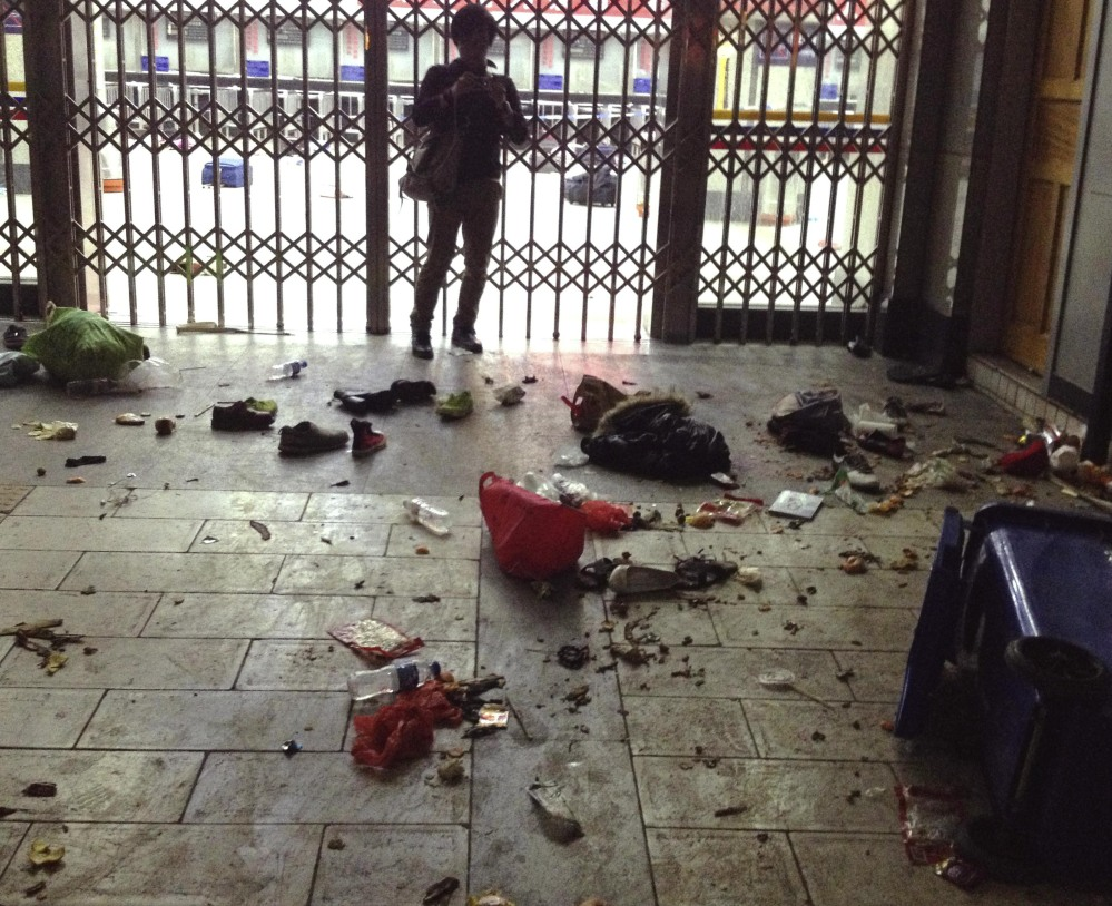 Scattered luggage is seen inside the Kunming Railway Station in Kunming on Saturday.