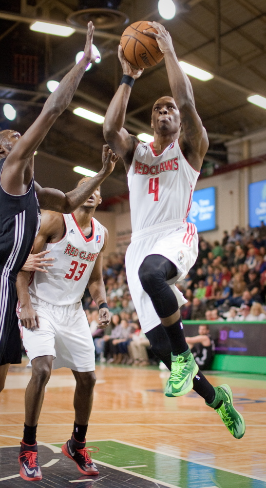 Frank Gaines of the Red Claws drives to the basket during Maine's 113-104 win over the Austin Toros Sunday at the Portland Expo. Gaines scored the last nine Red Claw points, finishing with 22 for the game.