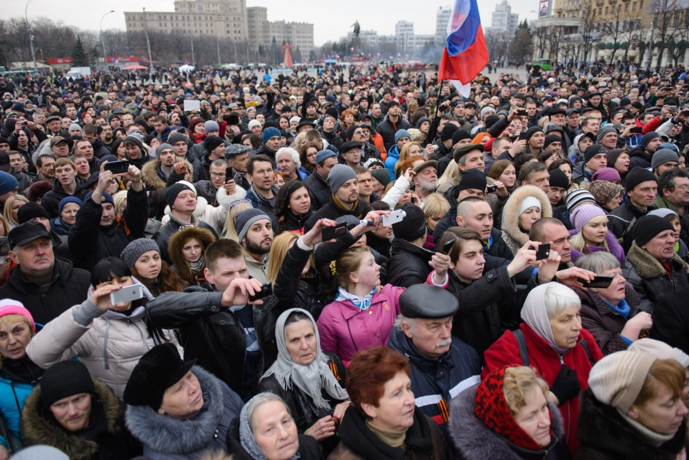 Pro-Russian demonstrators, holding a Russian flag, gather for a rally at the local administration building in the northeastern city of Kharkiv, Ukraine, Saturday.