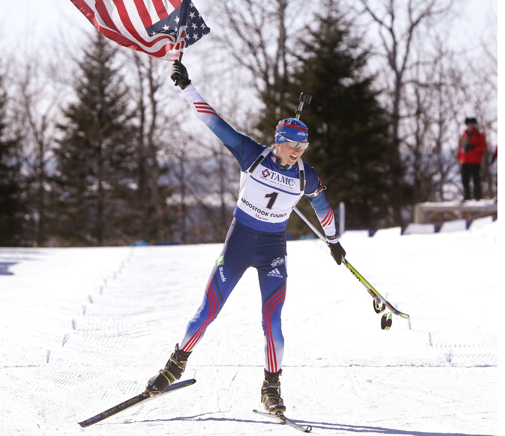 Sean Doherty of Center Conway, N.H., hoists the American flag high as he crosses the finish line in first place with a time of 28:51.8 in the youth men's 10-kilometer pursuit at the IBU Biathlon Youth/Junior World Championships at the Nordic Heritage Center in Presque Isle on Sunday.